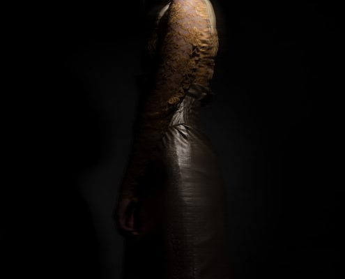 Fashion photographer Amsterdam editorial golden lace dress dark spiritual photo
