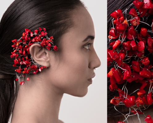 Ear piece with red coral by Haruco-vert - Fashion photo by Ruud van Ooij