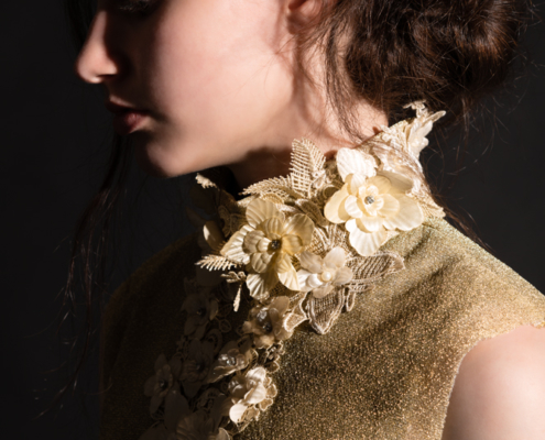 Golden top with flowers dark photography - Fashion editorial Ruud van Ooij