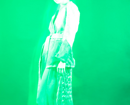 Monochrome green spiritual fashion photo with transcending model - Fashion photography by Ruud van Ooij