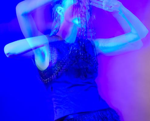 Feather skirt dark fashion photo movement - Fashion editorial by Ruud van Ooij