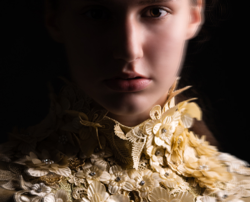 Golden dress with flowers dark photography - Fashion editorial Ruud van Ooij