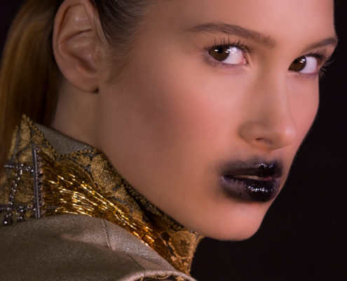 Golden lace dress with smudged black lips portrait - Fashion photography by Ruud van Ooij