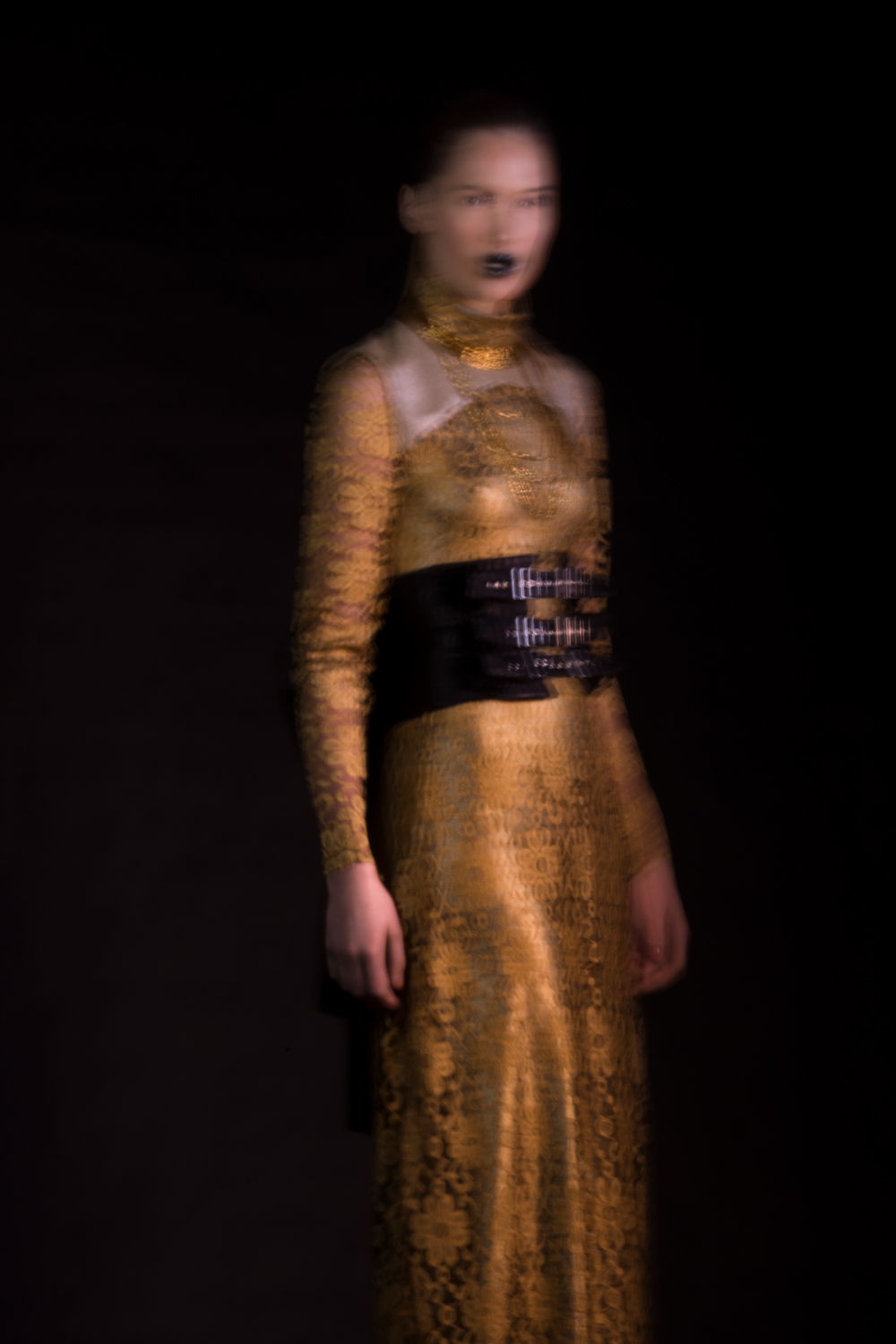 Golden lace dress with black corset belt in movement by Haruco-vert - Fashion photography by Ruud van Ooij