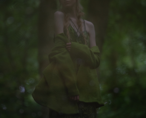 Green dress with green coat reflected in water - Fashion photography Ruud van Ooij