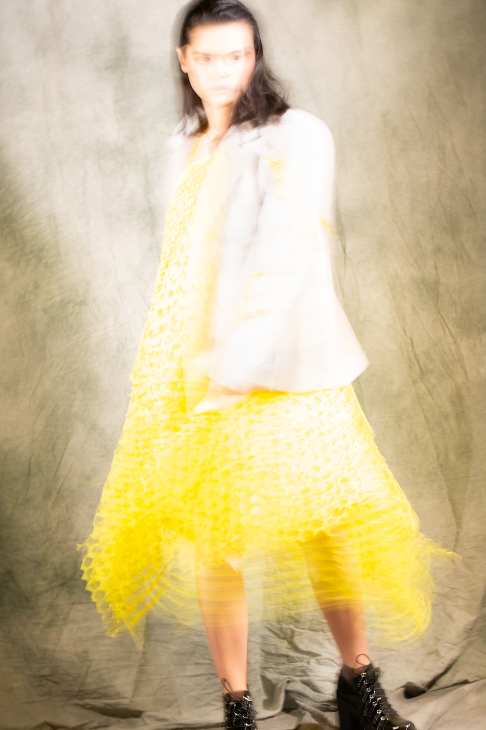 Yellow dress with embroidered jacket in movement - Fashion campaign by Ruud van Ooij