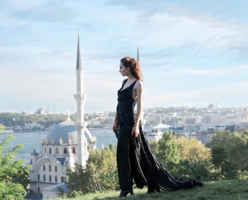 Istanbul fashion editorial black cut coat over black jumpsuit by Ruud van Ooij