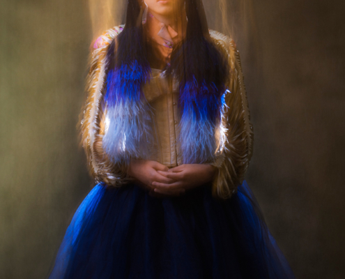 Blue tulle skirt with golden cut sleeves transcending - Fashion editorial Ruud van Ooij