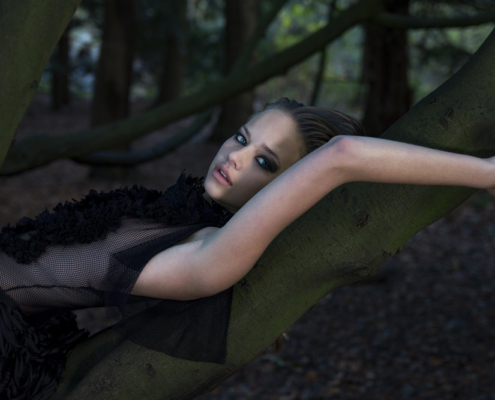 Black lace dress in woods Haruco-vert - Fashion photography Amsterdam Ruud van Ooij