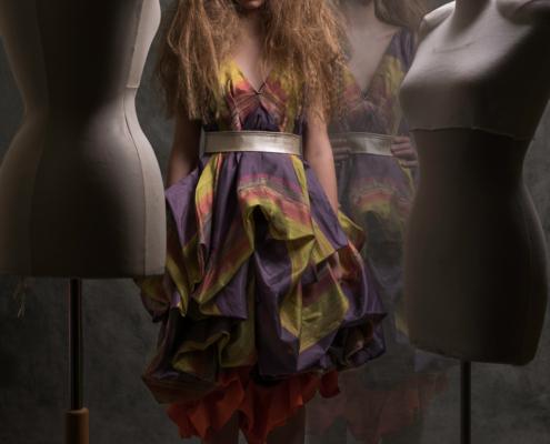 Purple dress doll between mannequins - Fashion photography Amsterdam Ruud van Ooij