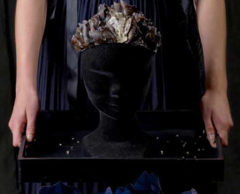 Blue dress with black cut coat and headpiece symbolism - Fashion still life Ruud van Ooij