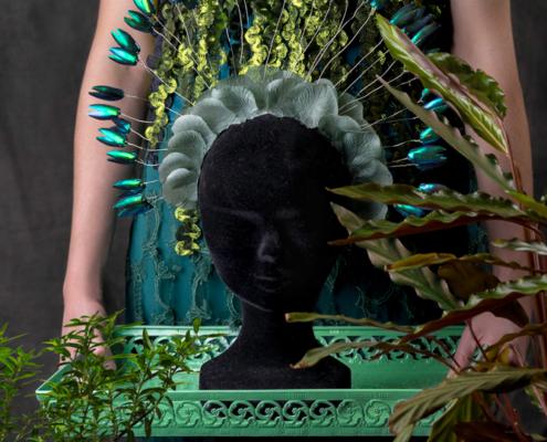 Green top with beetle wing halo headpiece symbolism - Fashion still life Ruud van Ooij
