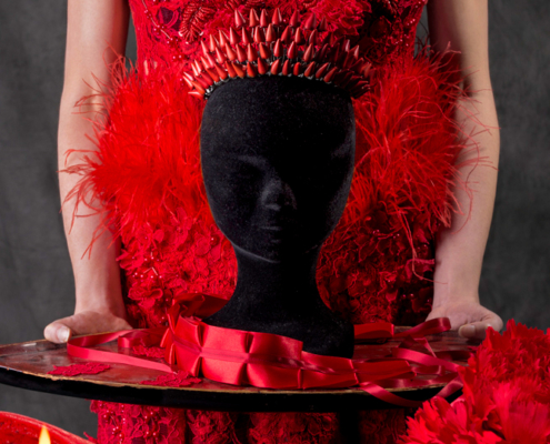 Red dress with red howlite crown symbolism - Fashion still life Ruud van Ooij