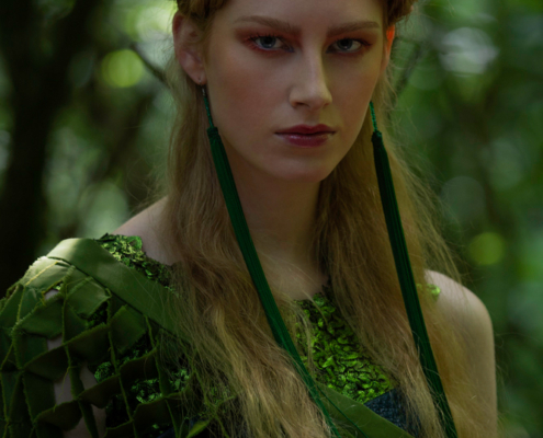 Fashion portrait with braided hair in green outfit - Fashion photography Ruud van Ooij