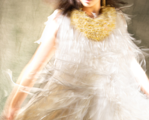 White ribbon dress in movement - Fashion campaign by Ruud van Ooij